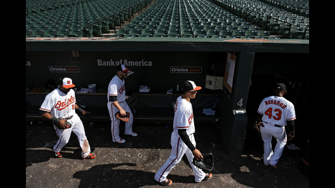 Orioles players walk into the clubhouse after defeating the White Sox 8-2.
