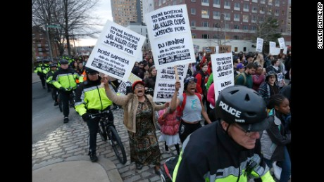 Demonstrators are escorted by police during a march near the Boston Police headquarters on April 29.