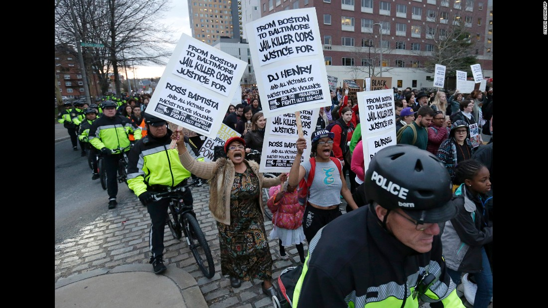Demonstrators march with a police escort near Boston police headquarters on April 29.