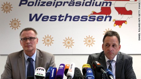 Albrecht Schreiber, left, Frankfurt's attorney general, and Stefan Mueller, head of the police department in Wiesbaden, Germany, address the media during a news conference in Wiesbaden.