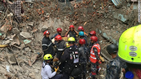 Hero Rescuer Kathmandu Nepal. Rescuers go down into the site where an 18-year-old was rescued Thursday.