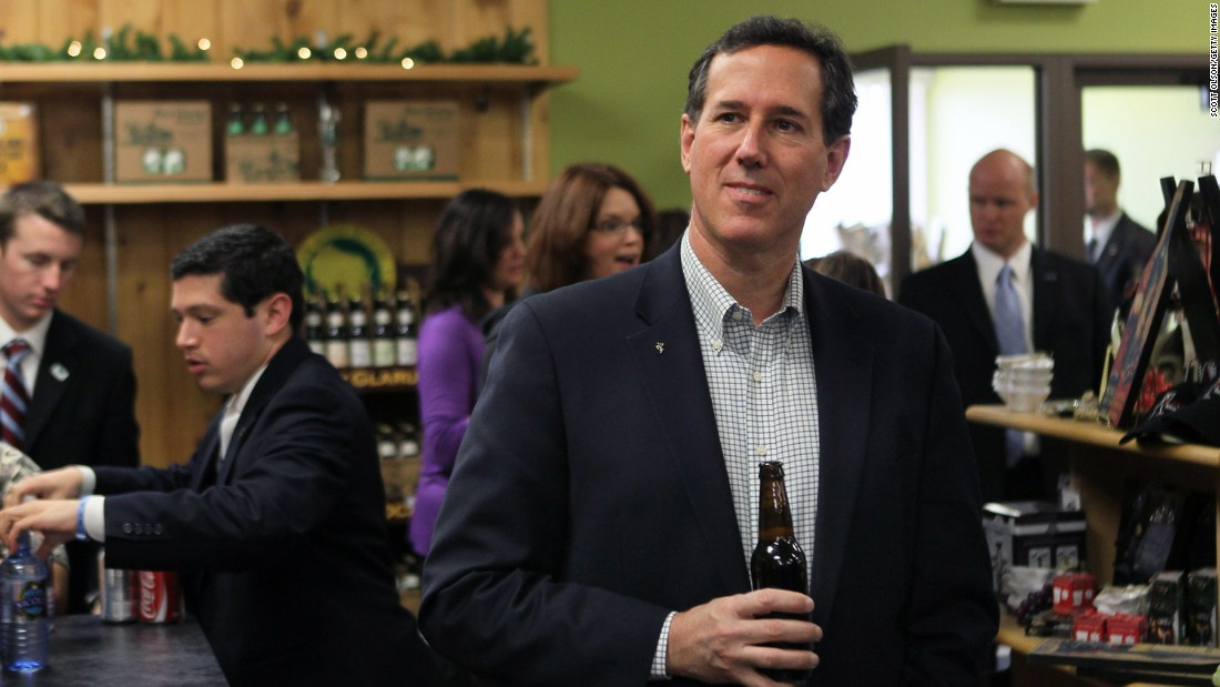 Santorum tries one of the local craft beers while having lunch at Simon's Specialty Cheese following a campaign stop in Appleton, Wisconsin, on April 2, 2012.
