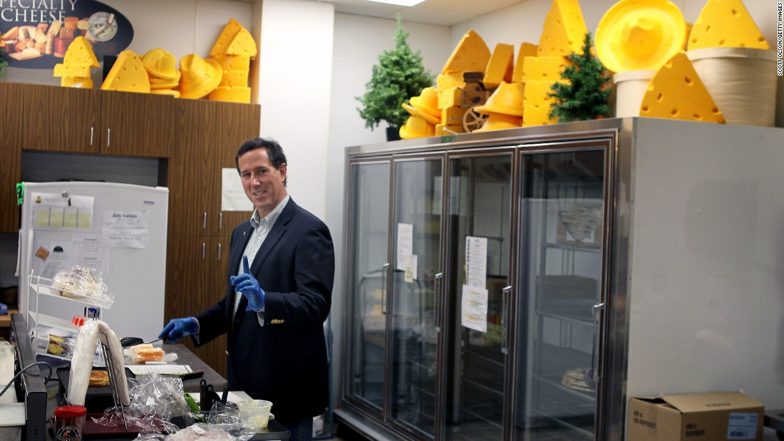 Santorum makes a grilled cheese sandwich during a campaign stop at Simons Specialty Cheese on April 2, 2012, in Appleton, Wisconsin.