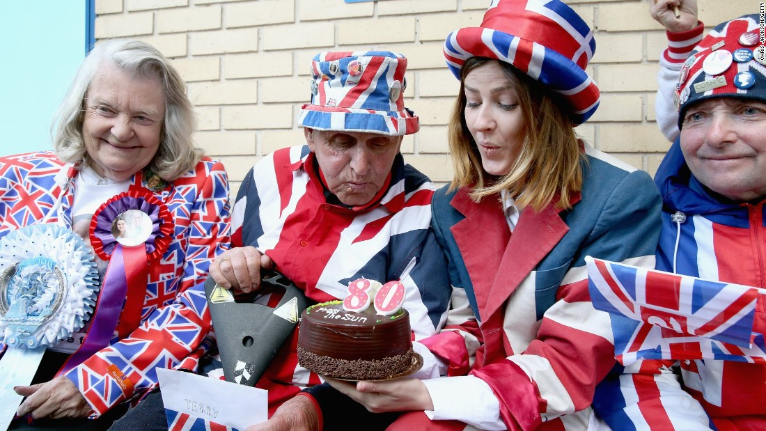 APRIL 30 -- LONDON: Royalist Terry Hutt blows out the candles on a cake on his 80th birthday as he waits for a new royal baby at the Lindo wing of St Mary's Hospital.