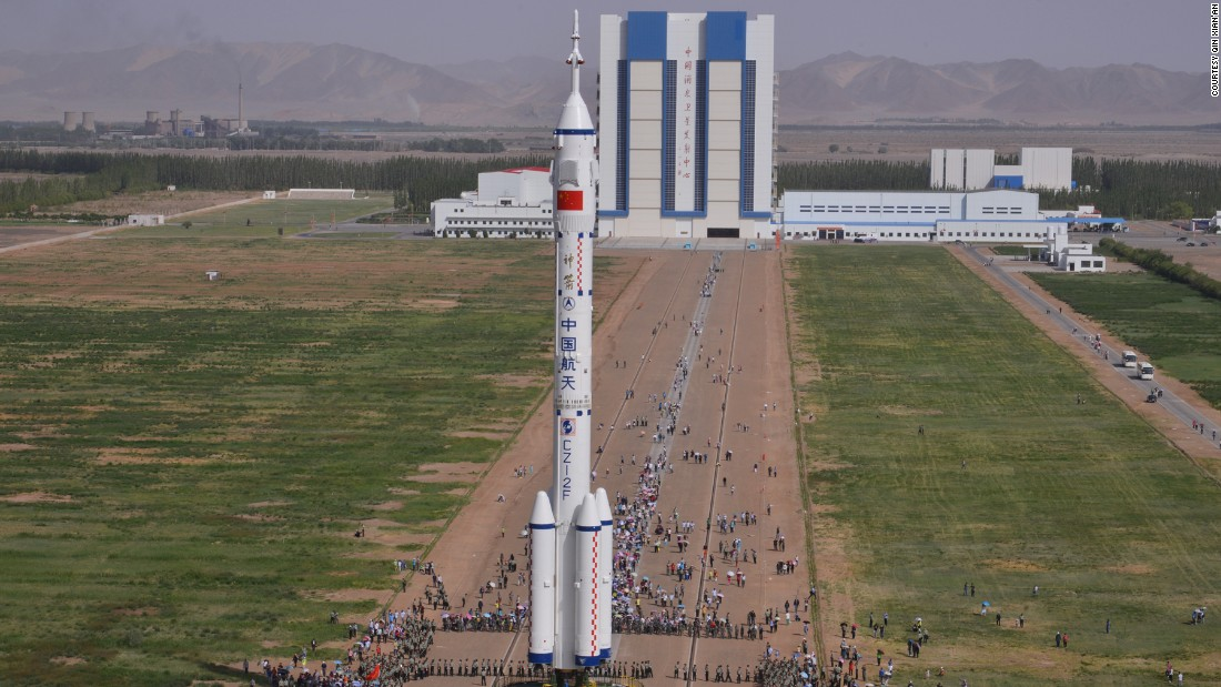 The Shenzhou-10 spacecraft is transferred to the launch site at the Jiuquan Satellite Launch Center on the day of the launch.