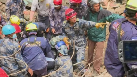 Survivors pulled out of rubble in Nepal