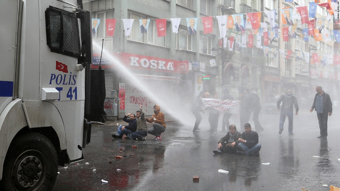 "Police use water cannons on May Day demonstrators in Istanbul, Turkey, on Friday, May 1. Clashes erupted between police and protesters, who defied a government ban  on marching to Taksim Square. Rallies around the world marked <a href=""http://www.cnn.com/2013/09/03/world/may-day-fast-facts/index.html"">May Day</a>, referred to as International Workers' Day in many countries."