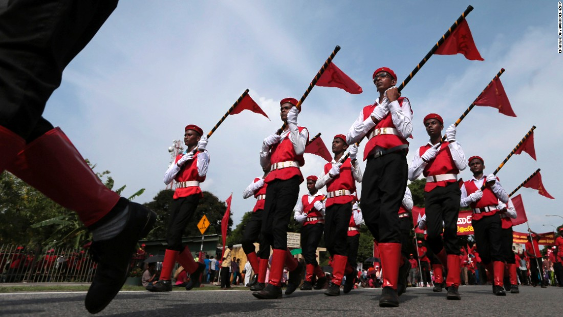 Members of the Sri Lankan Marxist political party People's Liberation Front march during a rally in Colombo, Sri Lanka.