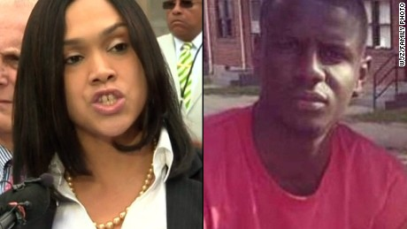 Baltimore State's Attorney Marilyn Mosby, left, and Freddie Gray