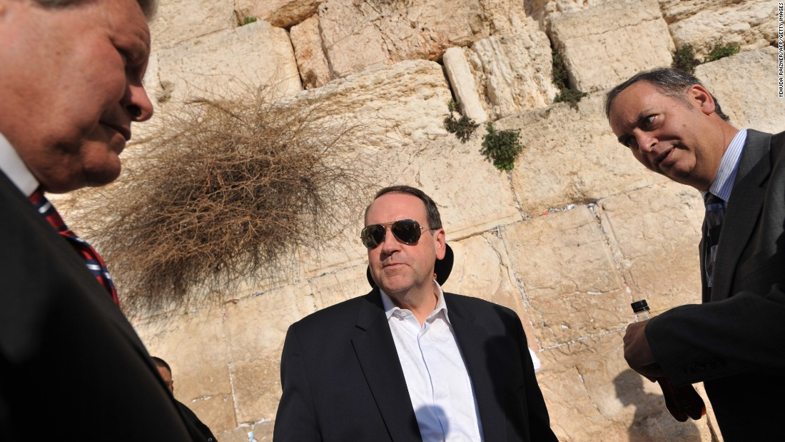 Huckabee, center, visits the Western Wall in Jerusalem on February 1, 2010.
