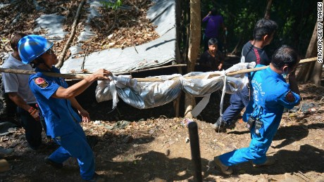 Thai police discover mass graves in jungle