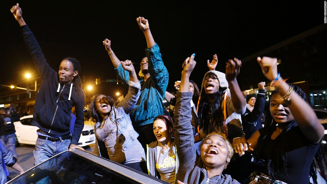 Demonstrators celebrate the announcement that six officers were charged May 1 in Gray's death.