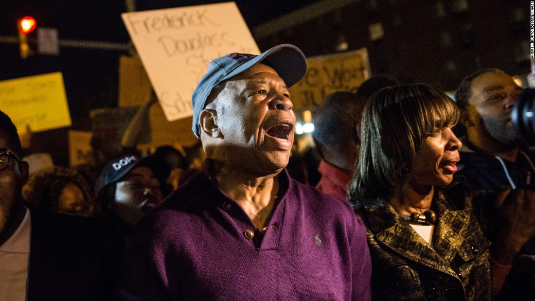 U.S. Rep. Elijah Cummings, D-Maryland, helps clear Baltimore streets of protesters on May 1.