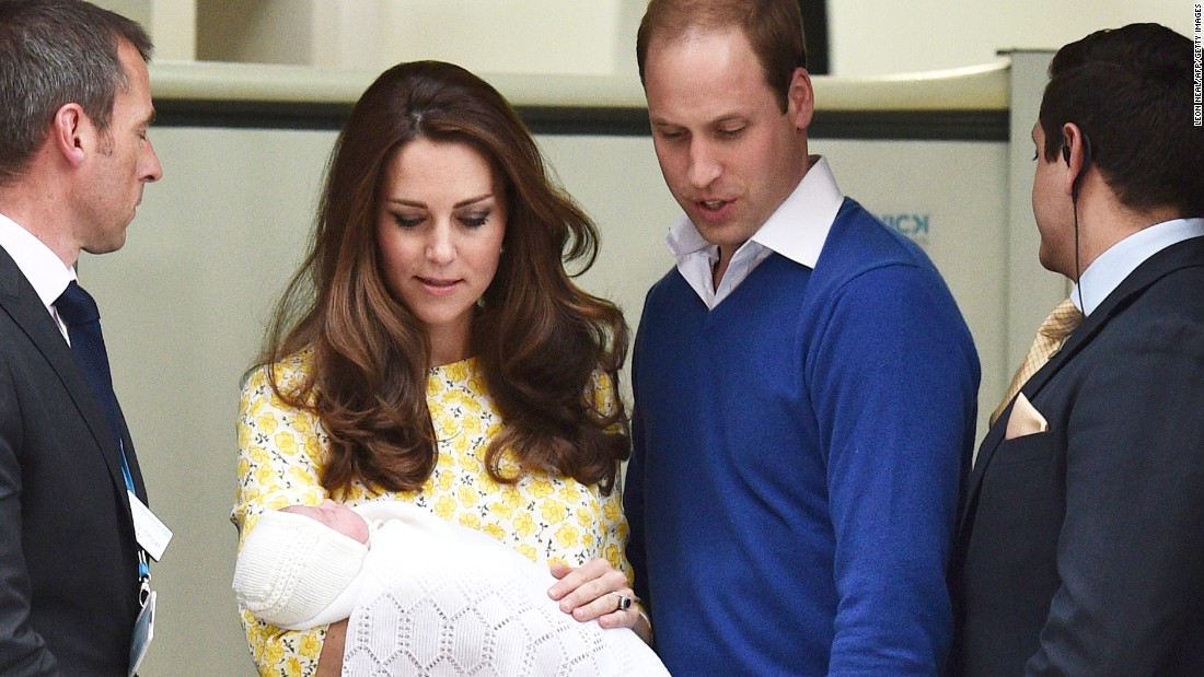 William and Catherine present their newborn daughter as they leave a London hospital in May.