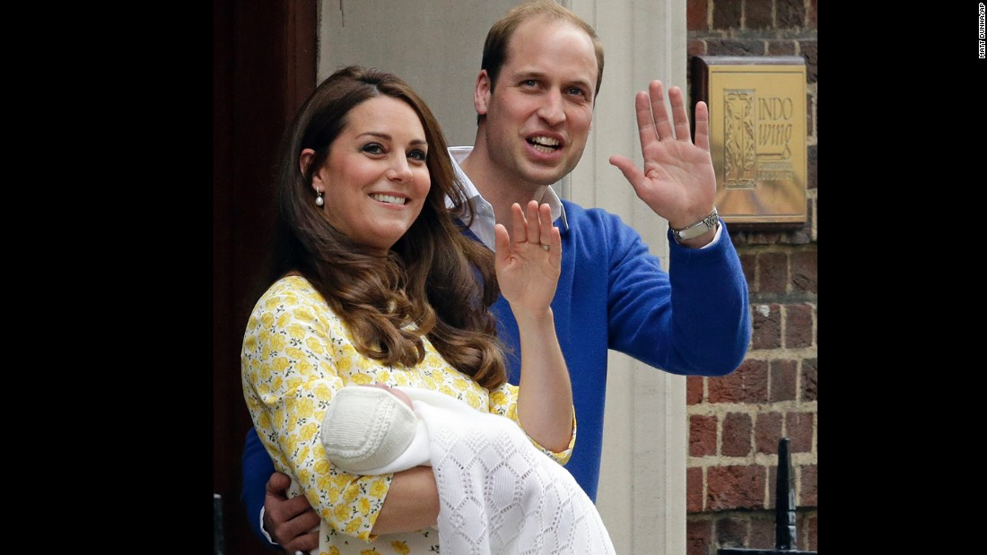 William and Catherine and their newborn princess wave to the media.