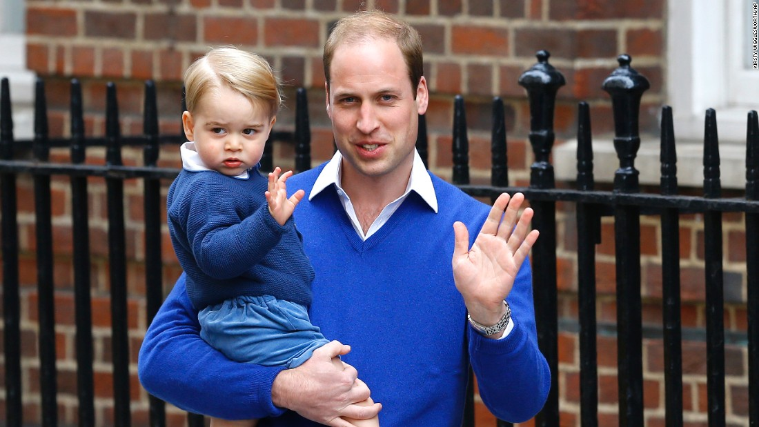 Prince William and his son wave as they visit the hospital after the announcement of the princess' birth.