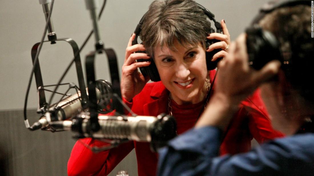 Fiorina, left, puts on headphones before participating in a radio debate with incumbent U.S. Sen. Barbara Boxer, D-California, in Washington, as co-moderator Gabriel Lerner, metro editor of La Opinion, does the same at local public-radio affiliate KPCC studios September 29, 2010, in Pasadena, California.