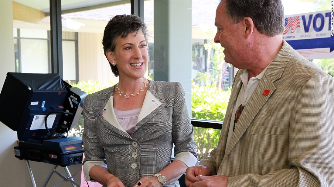 Fiorina, left, smiles with her husband Frank Fiorina, right, after casting their ballots at a polling place June 8, 2010, in Los Altos Hills, California.