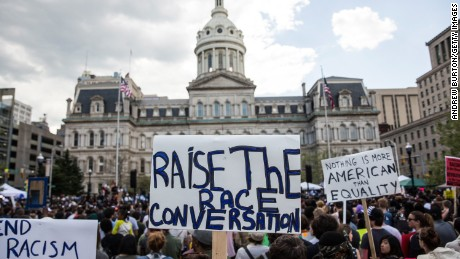 Protesters rally in front of City Hall on Saturday May 2 in Baltimore.