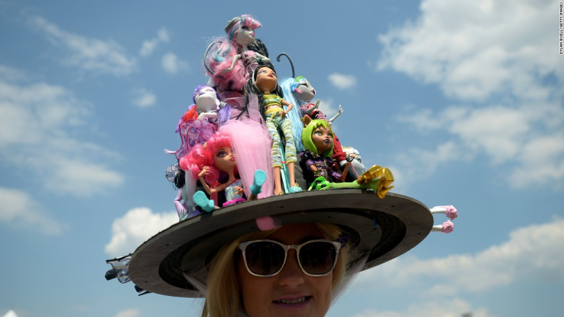 A collection of dolls makes up the decorations on this unique hat at the 141st running of the Kentucky Derby at Churchill Downs on Saturday, May 2, in Louisville.