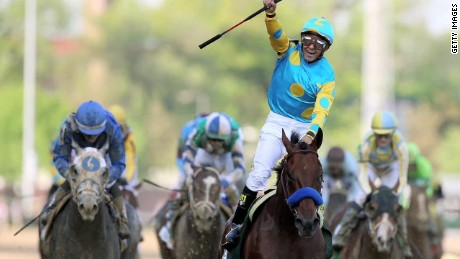American Pharoah gallops to victory at Kentucky Derby