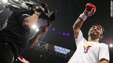 Manny Pacquiao acknowledges the crowd before the start of his world welterweight championship bout against Floyd Mayweather Jr.