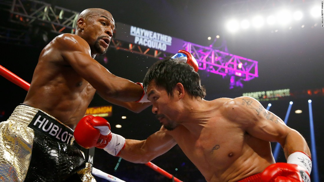 Floyd Mayweather and Manny Pacquiao exchange punches on Saturday, May 2, at their championship fight in Las Vegas.
