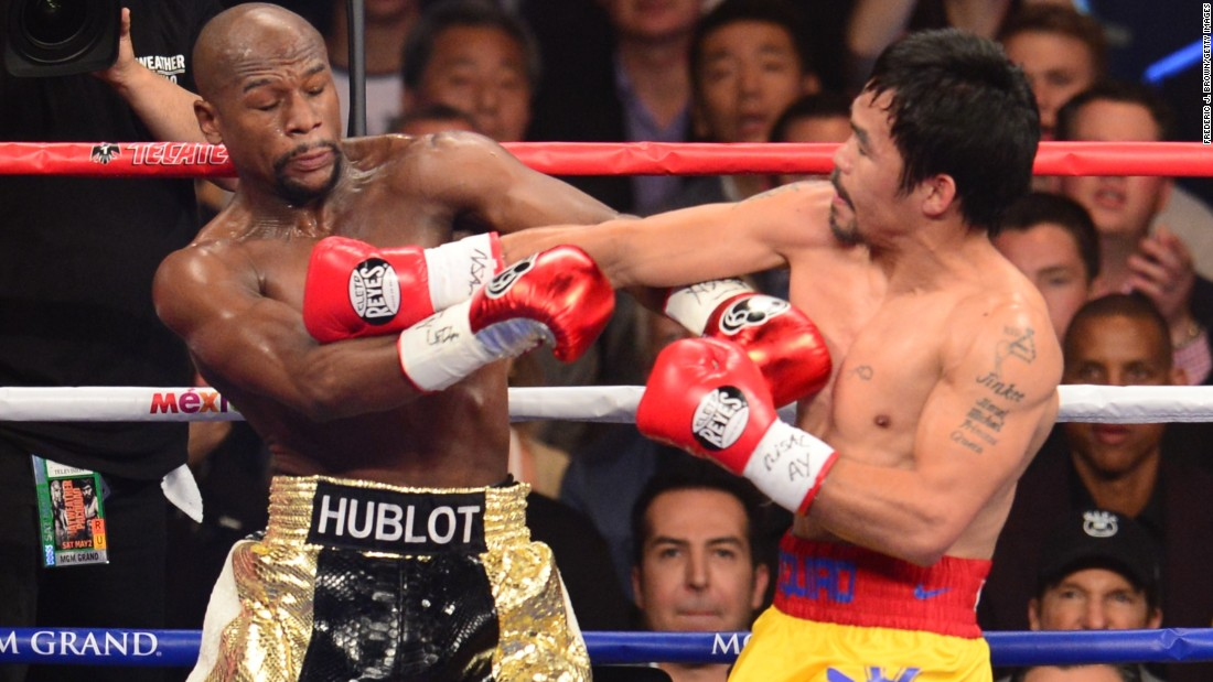 Floyd Mayweather and Manny Pacquiao go toe to toe.