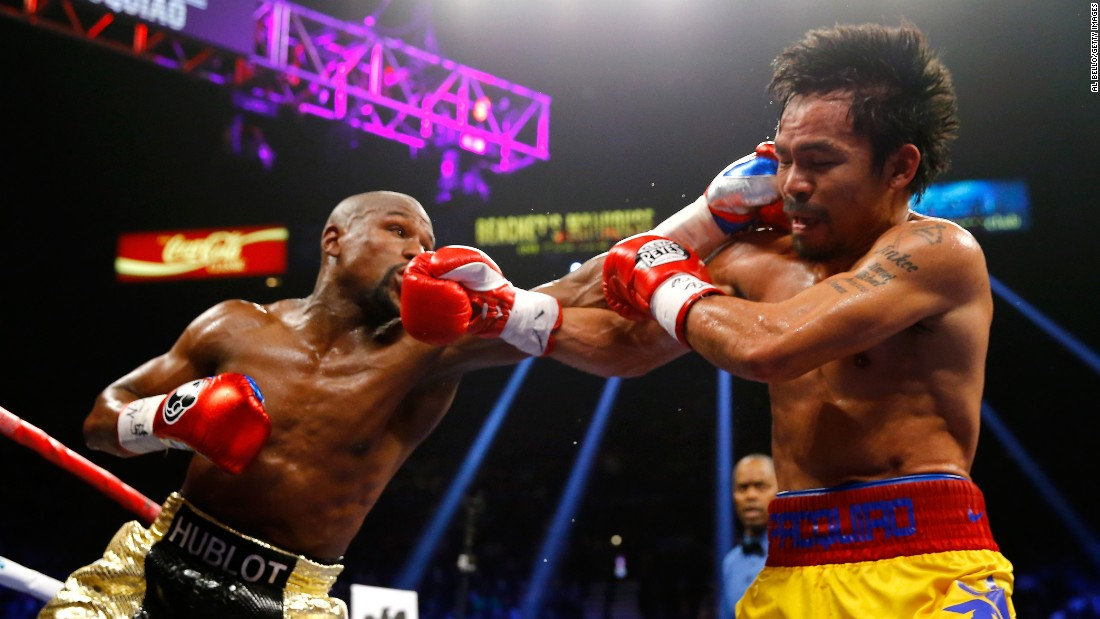 Floyd Mayweather connects with a strong left on Manny Pacquiao at the welterweight world championship unification fight.