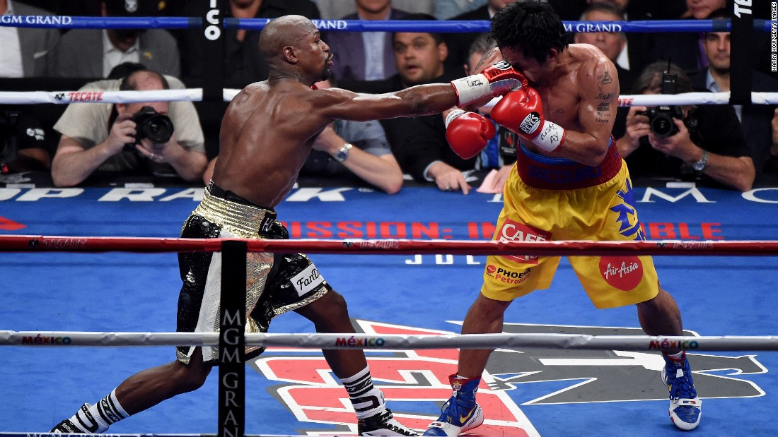 Floyd Mayweather, who looked strong late, connects during the 12-round fight.