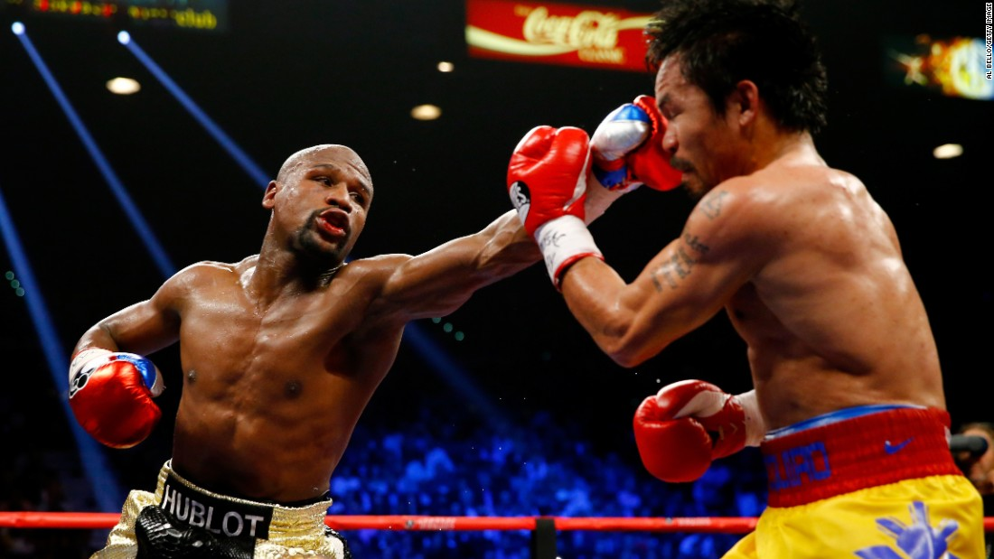 Floyd Mayweather throws a nasty left at Manny Pacquiao.
