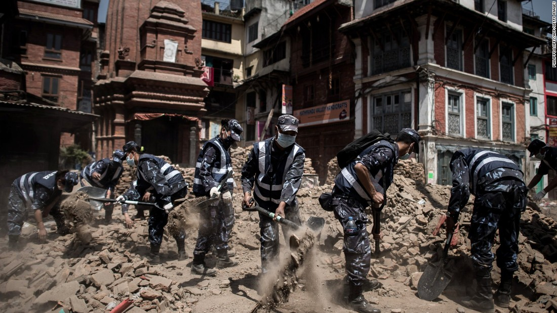 "Nepalese police officers clear debris from Durbar Square in Kathmandu on Sunday, May 3. A magnitude-7.8 earthquake centered less than 50 miles from Kathmandu <a href=""http://www.cnn.com/2015/04/28/asia/nepal-earthquake/index.html"">rocked Nepal with devastating force</a> Saturday, April 25. The earthquake and its aftershocks have turned one of the world's most scenic regions into a panorama of devastation, killing and injuring thousands."