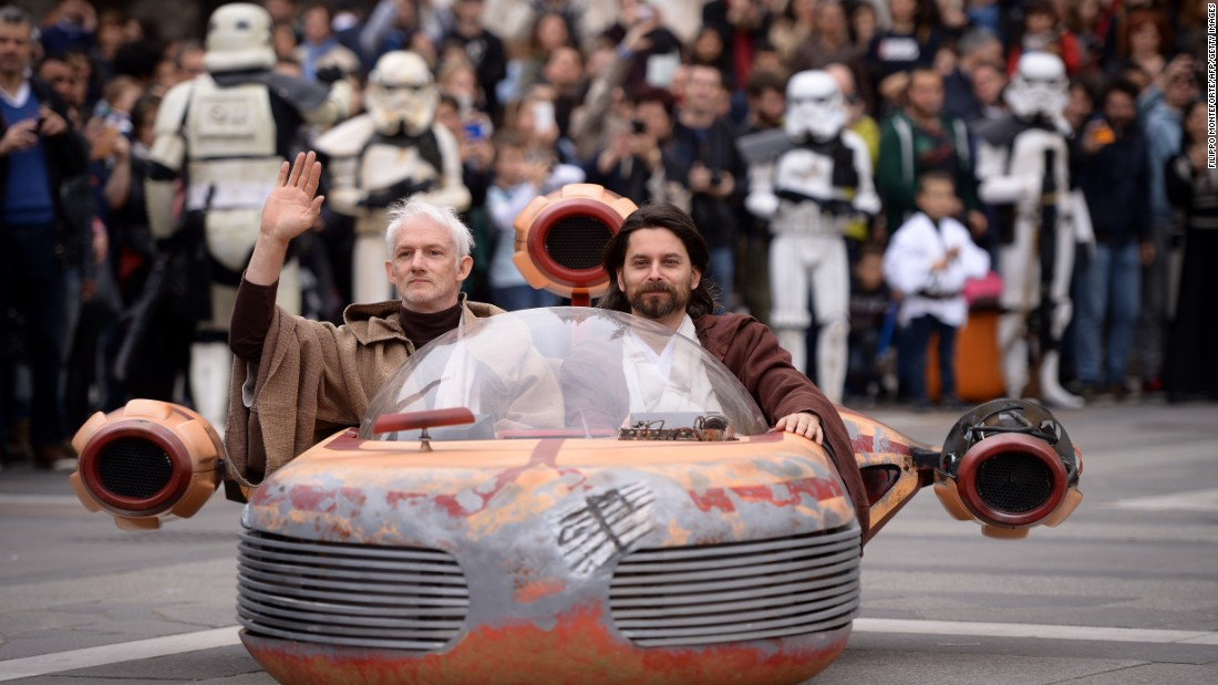 "Cosplayers dressed as ""Star Wars"" characters Obi Wan Kenobi and Anakin Skywalker attend a ""Star Wars"" Day event in Milan, Italy, on May 3, as fans get a jump on celebrating ""Star Wars Day."""
