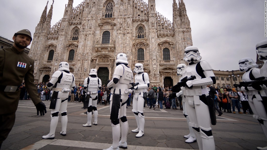 """Star Wars"" fans dressed as stormtroopers stand in front of Milan's Duomo on May 3."