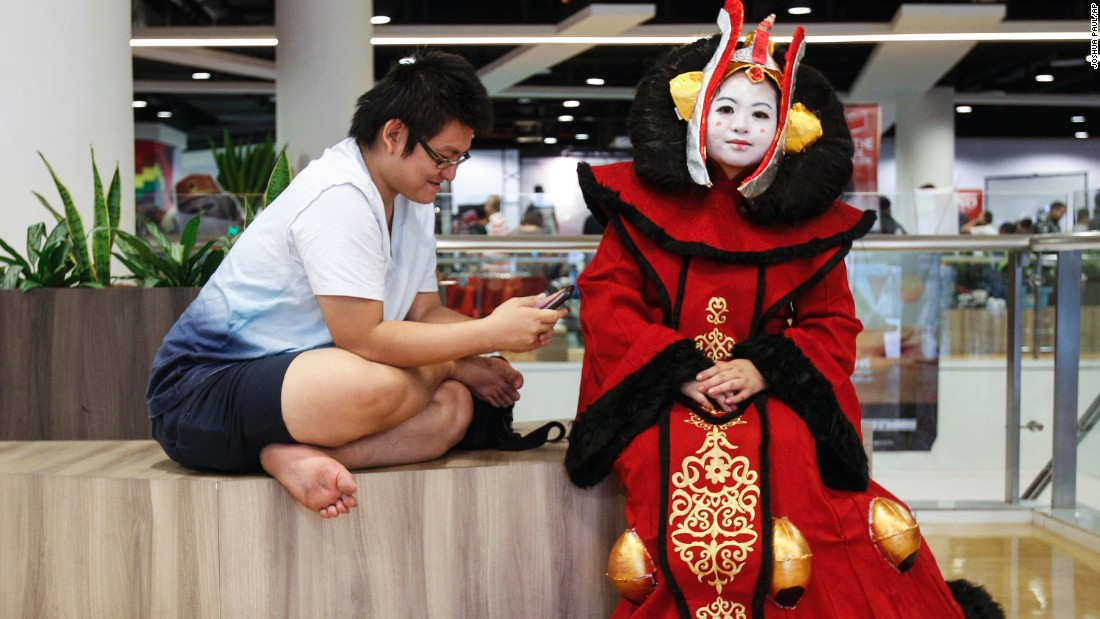 """Star Wars"" fan Michelle Chee, right, dressed as Padme Amidala takes a rest during the ""Star Wars Day"" gathering in a mall downtown Kuala Lumpur, Malaysia, on May 2."