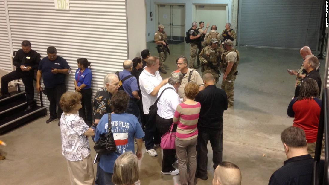People are sequestered by members of the Garland Police Department inside the Curtis Culwell Center.