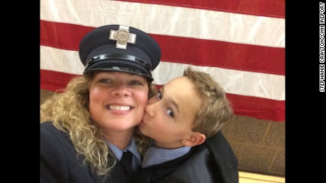 """In 2014, I completed the Massachusetts Fire Academy for the City of Cambridge, in which I grew up. I am a 42-year-old divorced mother with custody of my son. My proudest moment was being able to have my son pin my badge on my uniform during the badge ceremony for the city."""