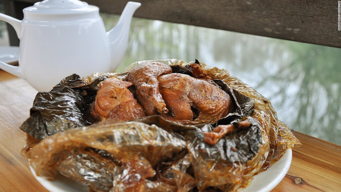 The chicken itself is stuffed with pork and mushrooms, wrapped in lotus leaf and baked in clay.