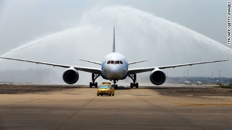 China's first Boeing 787 Dreamliner delivered to China Southern Airlines receives a ceremonial water salute upon arrival at the airport in Guangzhou, southern China's Guangdong province on June 2, 2013. China's first Boeing 787 arrived in the country on June 2, state-run media said, less than two weeks after Beijing regulators approved the aircraft, which had faced safety problems.   CHINA OUT      AFP PHOTO        (Photo credit should read STR/AFP/Getty Images)