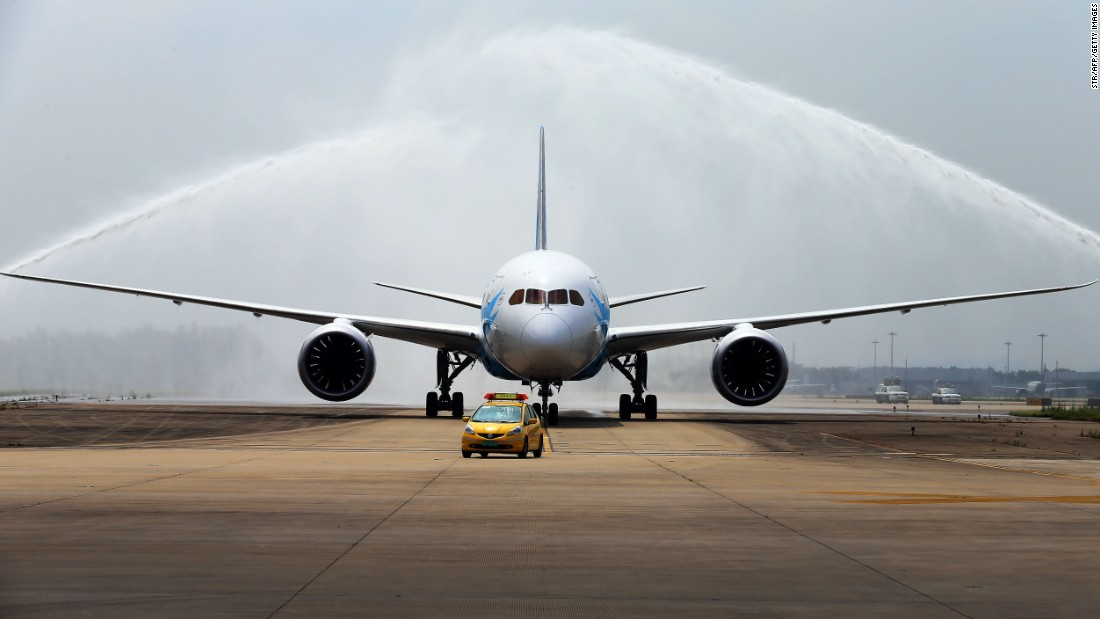 China's first Boeing 787 Dreamliner delivered to China Southern Airlines receives a ceremonial water salute upon arrival at the airport in Guangzhou, in southern China's Guangdong province, on June 2, 2013.