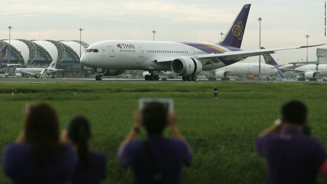 Thai Airways International officials take photos of the new Thai Airways 787-8 Dreamliner aircraft arriving at Suvarnabhumi Airport in Bangkok, Thailand, on July 18, 2014.