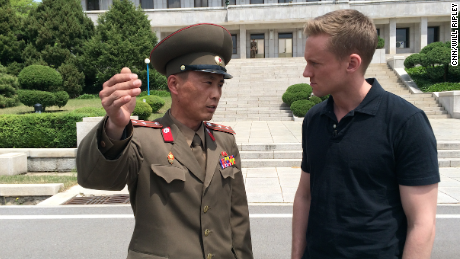 Junior Lt. Colonel Nam Dong Ho speaks to CNN correspondent Will Ripley. Ripley and his team were granted rare access to the DMZ. An estimated three quarters of of North Korea's standing army of more than one million is based near the heavily fortified border, which has been a flashpoint for violence at times.