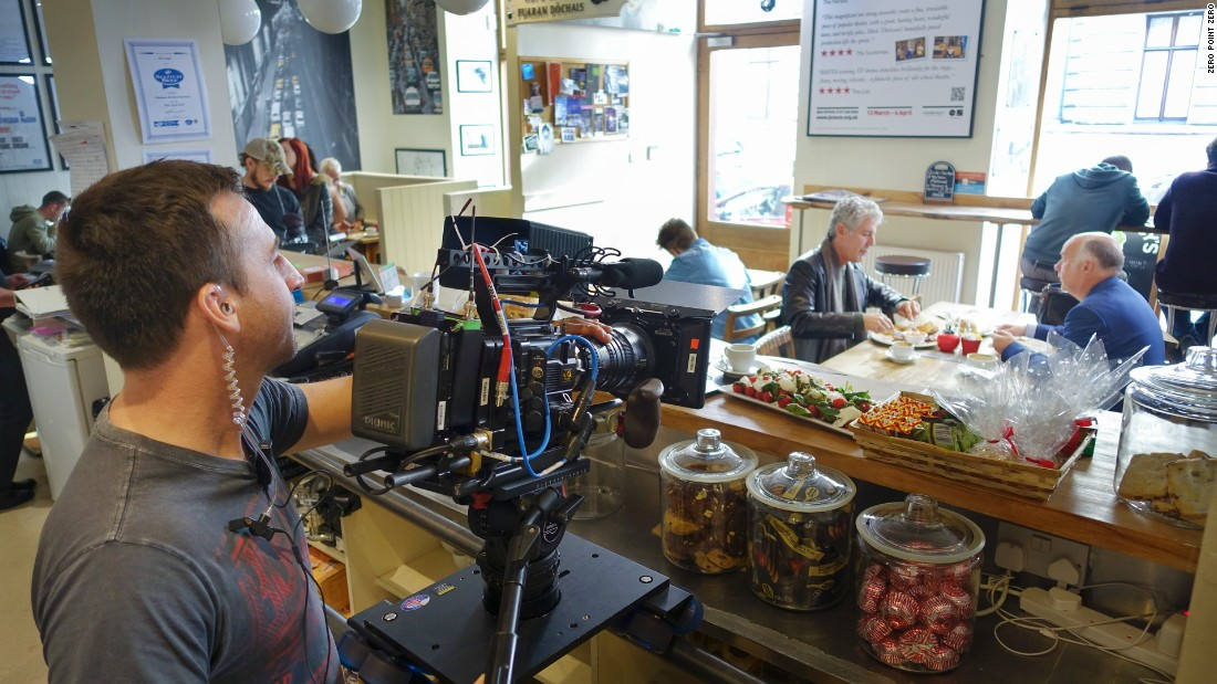 Director Nick Brigden shoots a scene at The Wee Guy's Cafe in Glasgow.