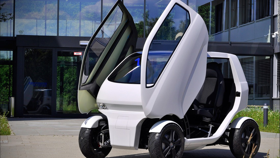 Known as the EOscc2, seen here with its doors open, it has a top speed of 65 km/h (or 40mph) and can travel 50 to 70 kilometers (30 to 44 miles) on a single four-hour full battery charge.