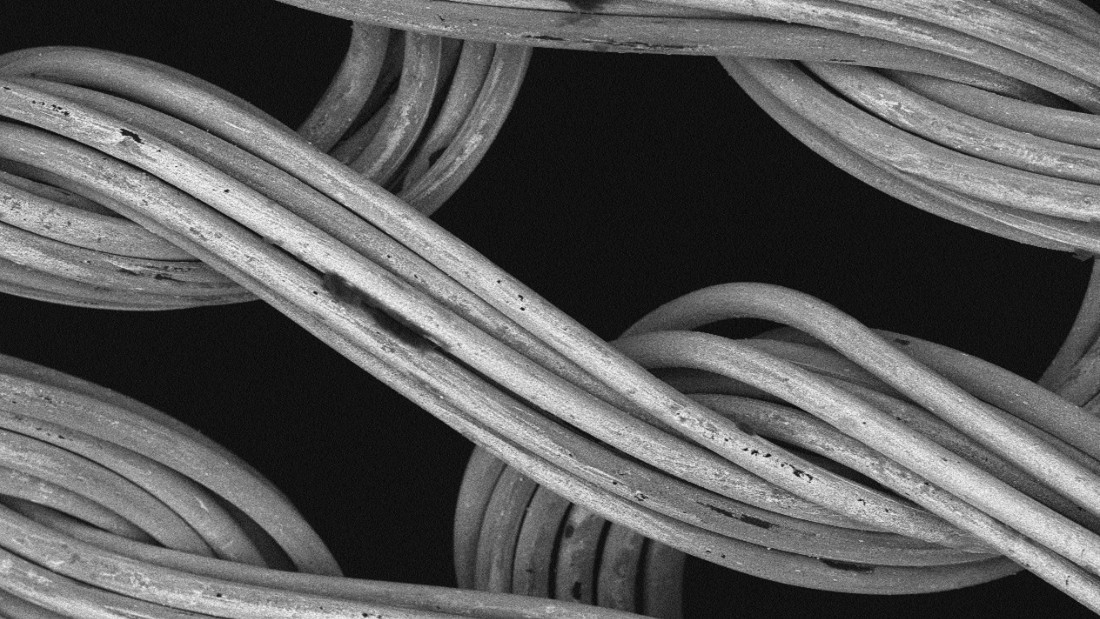 Conductive yarns -- most commonly made with silver -- are woven into fabrics to act as sensors that detect electrical signals, acting as electrocardiograms (ECGs). The data is transmitted wirelessly to a detection device, such as a smartphone. Pictured, the silver-coated X-STATIC fibers used by CircuiteX clothing as seen through an electron microscope.