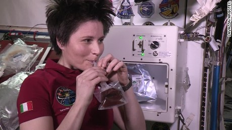 Italian astronaut Samantha Cristoforetti sips espresso on the International Space Station.