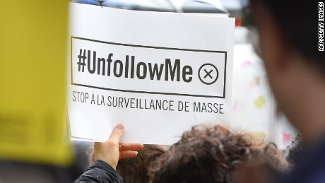 "Protesters holding placards reading ""Stop to mass surveillance"" take part on May 4, 2015 in Paris in a demonstration against the government's controversial bill giving spies sweeping new surveillance powers, deemed ""heavily intrusive"" by critics. AFP PHOTO / ALAIN JOCARDALAIN JOCARD/AFP/Getty Images"