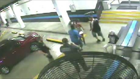 pkg Florida police officer punches kicks handcuffed woman_00000721