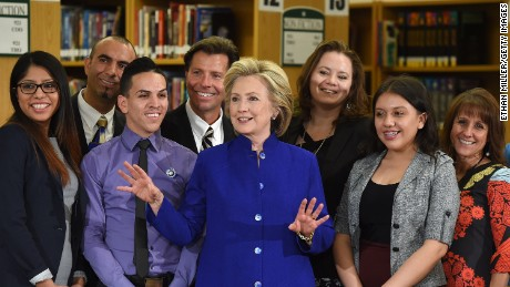 Democratic presidential candidate and former U.S. Secretary of State Hillary Clinton (C) poses with students and faculty after speaking at Rancho High School on May 5, 2015 in Las Vegas, Nevada. Clinton said that any immigration reform would need to include a path to 'full and equal citizenship.'