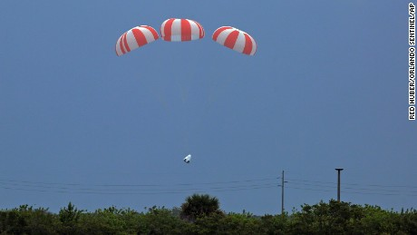 SpaceX's Dragon crew capsule parachutes deploy Wednesday , May 6, 2015 from Cape Canaveral, Fla. SpaceX fired the mock-up capsule to test the new, super-streamlined launch escape system for astronauts. (Red Huber/Orlando Sentinel via AP)